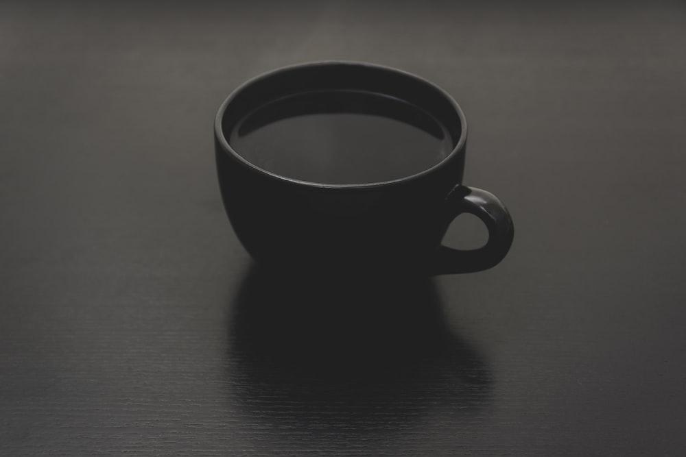 black ceramic mug with liquid close up photo