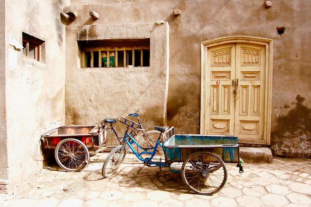 blue cart trike in front of door
