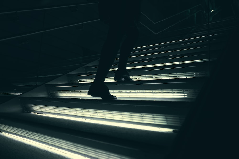 person walking on stairway
