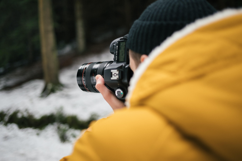 close up photography of man talking photo