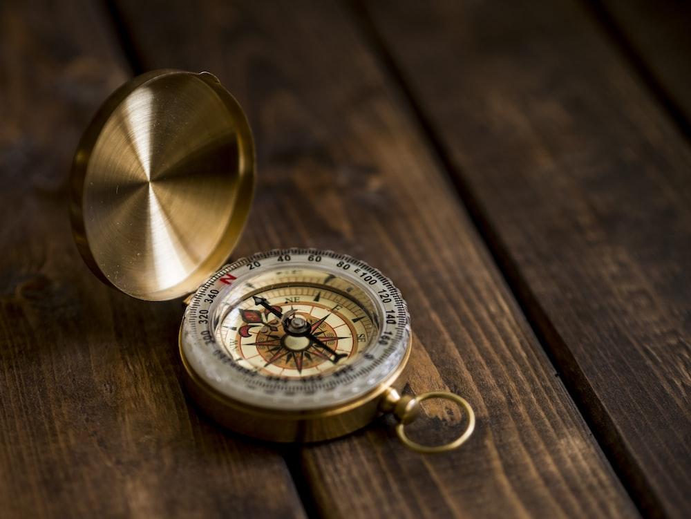 shallow focus photo of compass