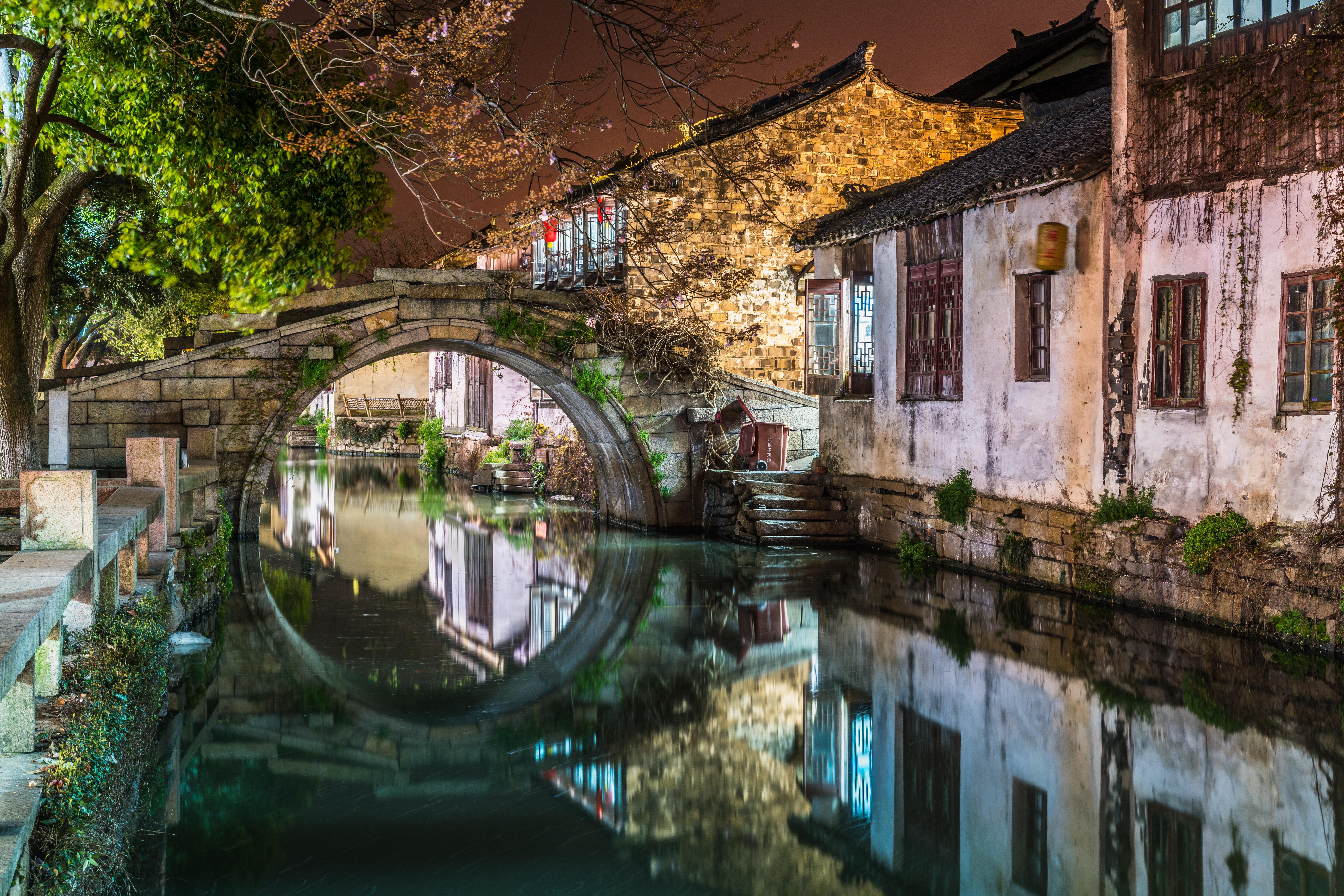 brick bridge over body of water