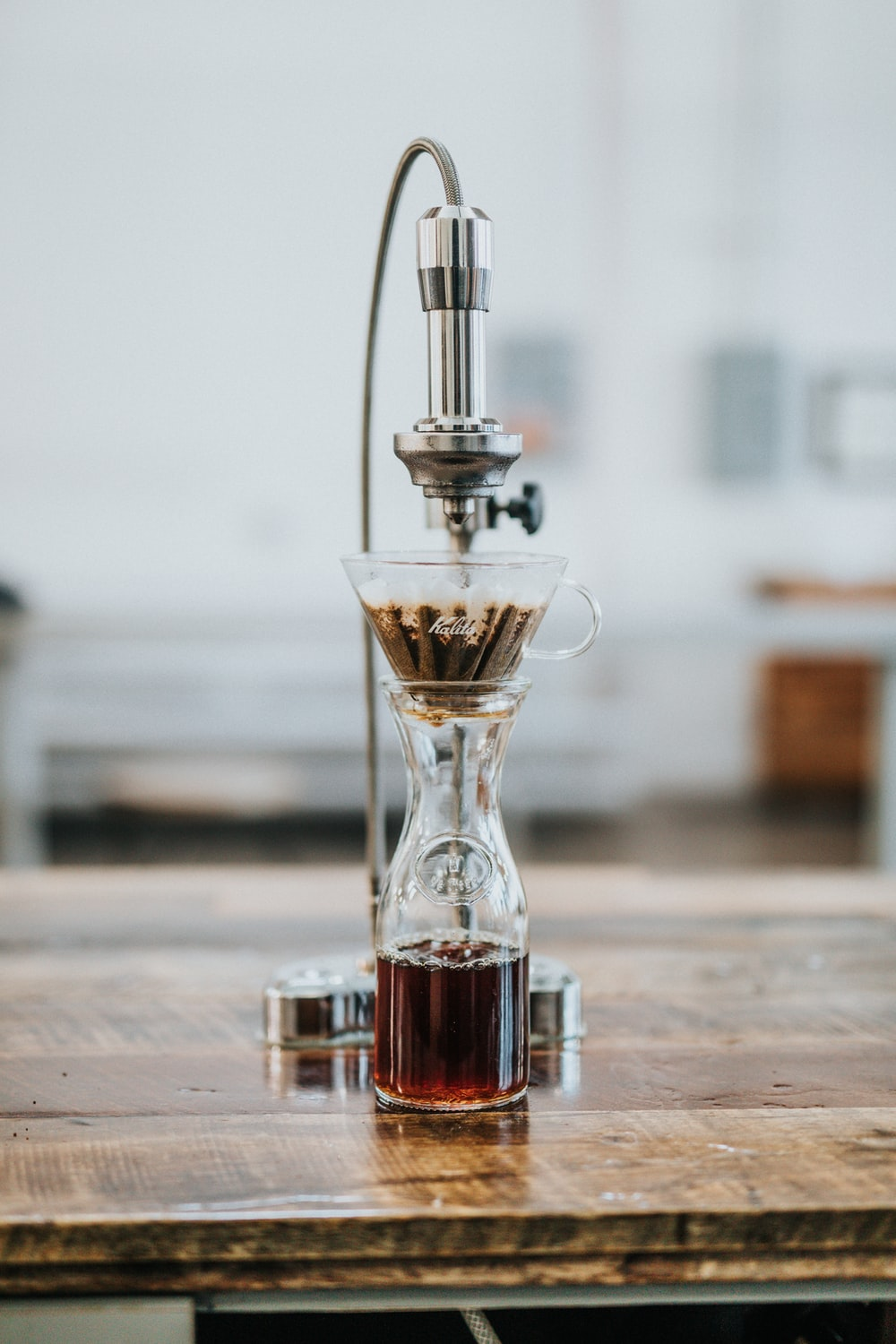 selective focus photography of coffee mixer on table