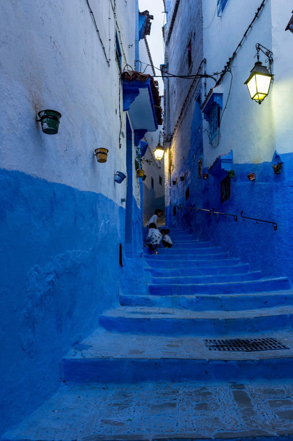 children climbing up blue stairs