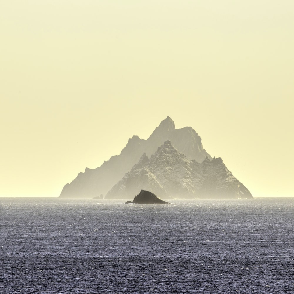 mountain at the center of the body of water