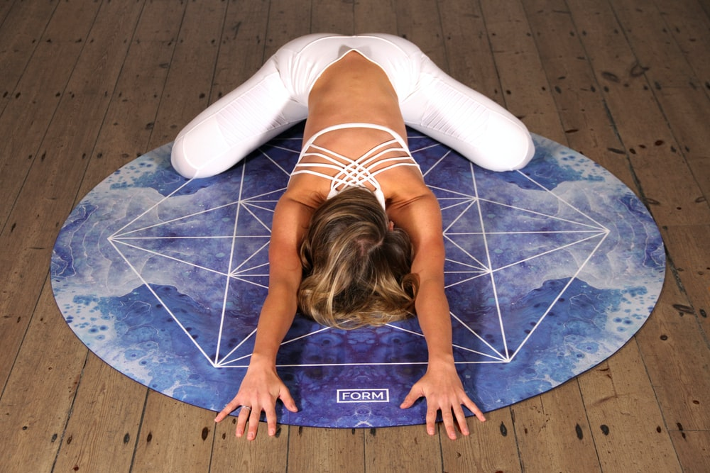woman doing yoga stunt