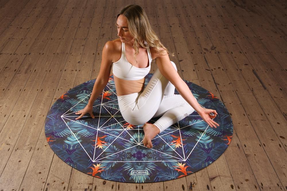 woman doing yoga on mat