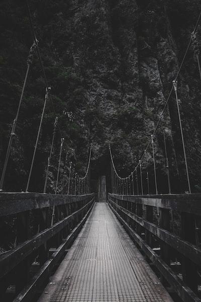 photo of bridge near mountain