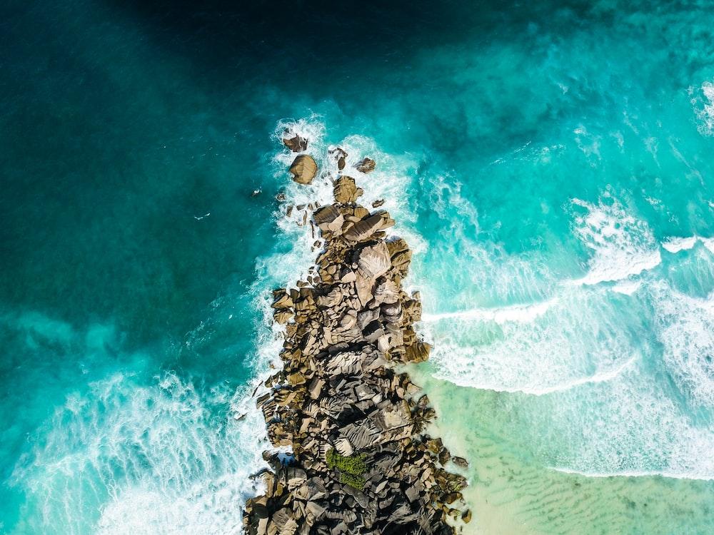 aerial view of rocks near coastline