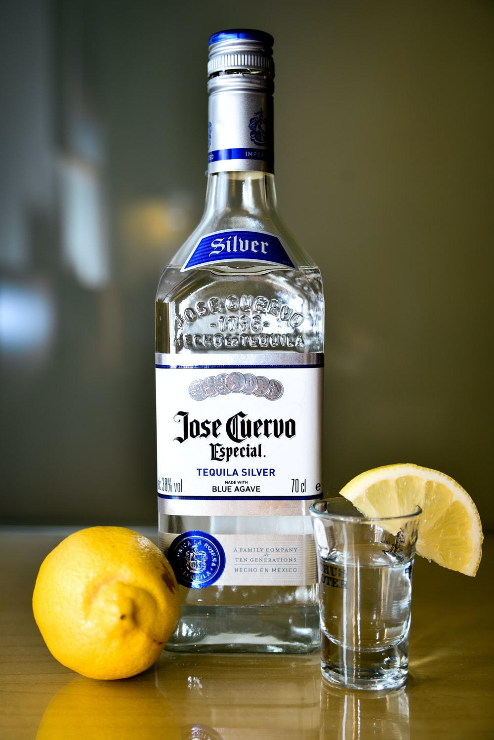 closeup photo of sealed Jose Cuervo tequila silver bottle