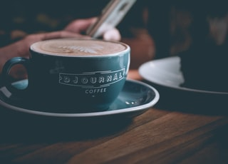 selective focus photography of blue cup and saucer