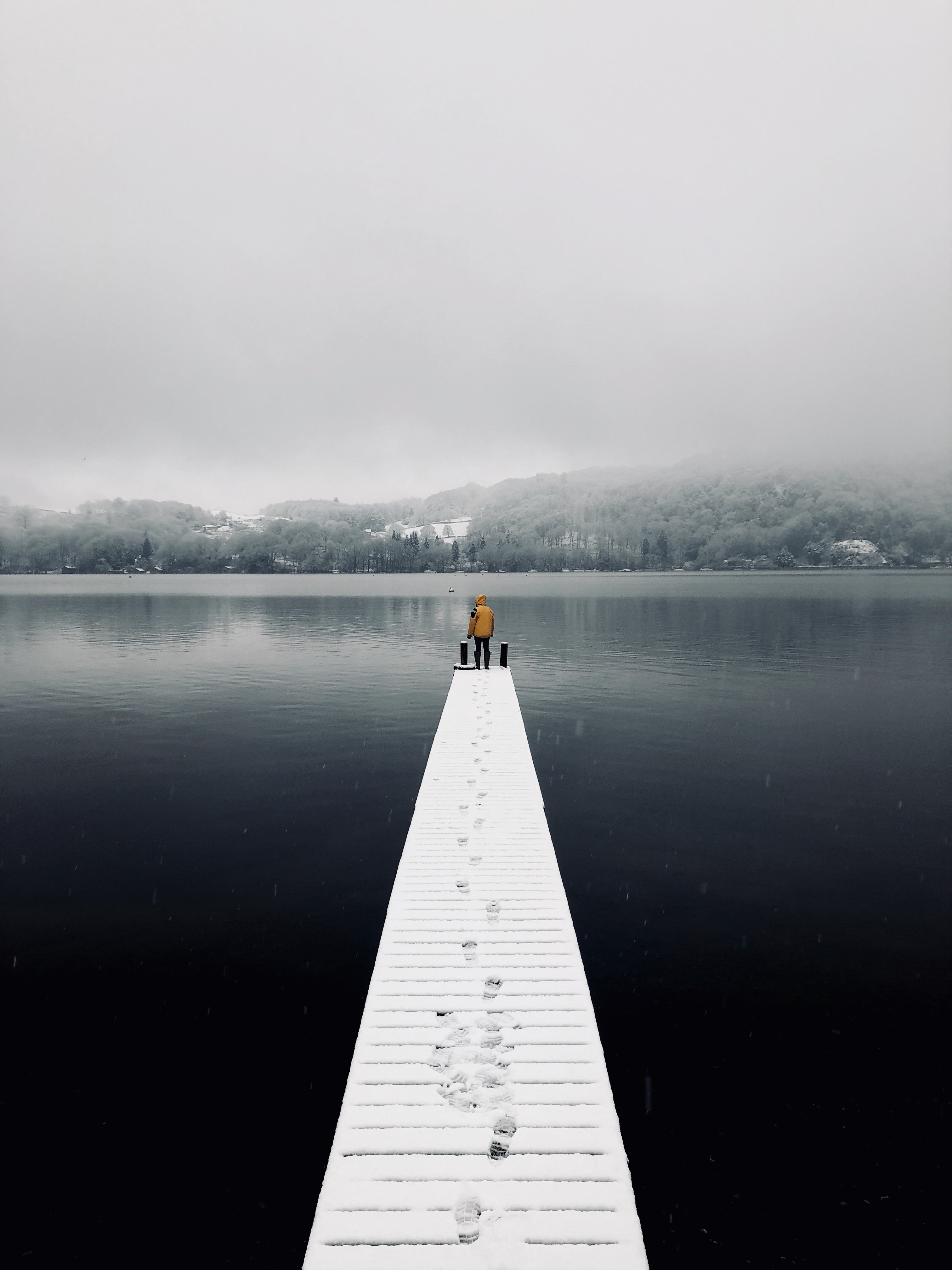 man standing on dock