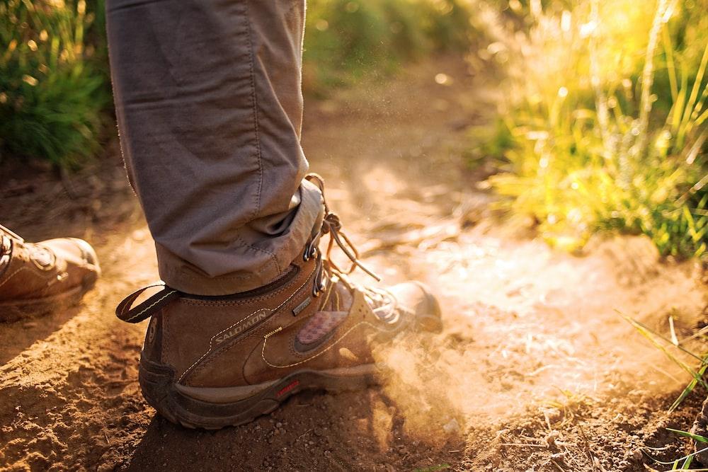 person wearing pair of brown sneakers