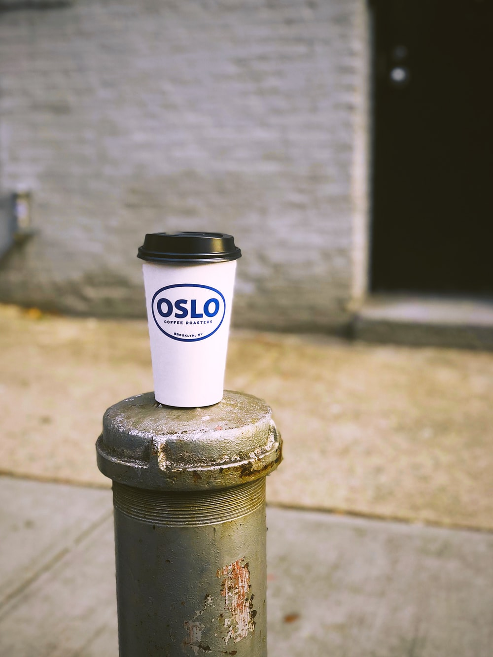 Oslo disposable cup on post near door