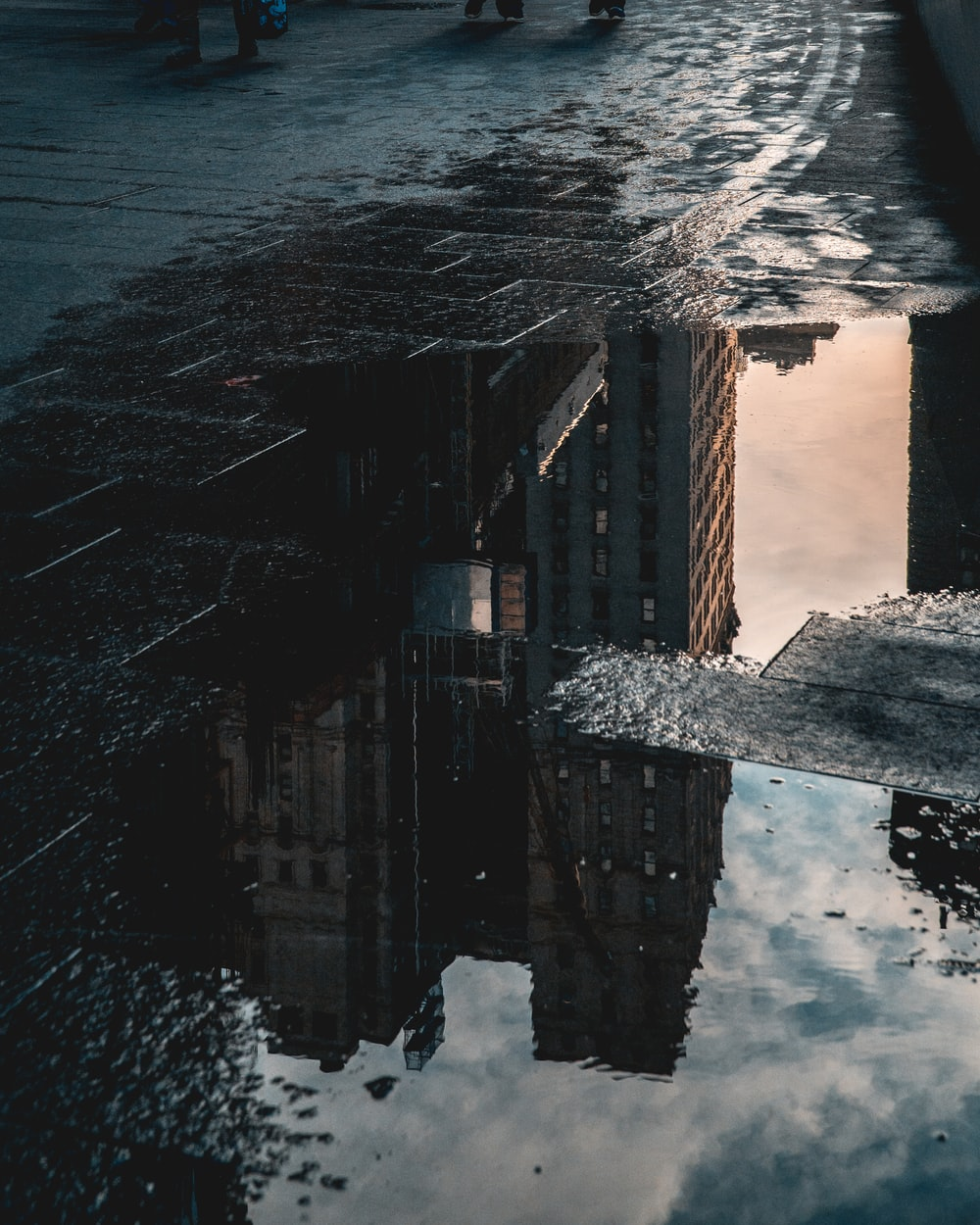 reflection photo of high-rise building