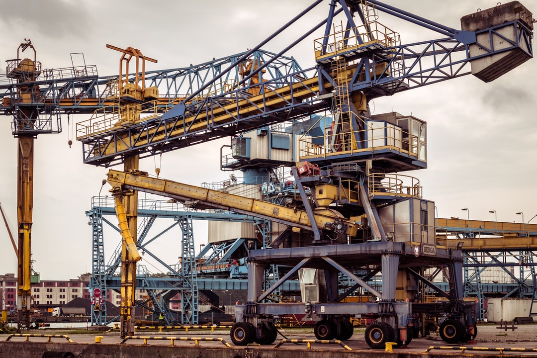Giant crane and other machinery in sea port and shipyard Gdynia, Poland.