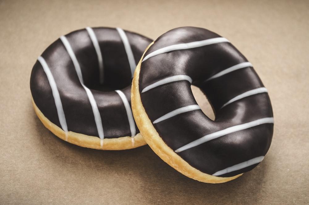 macro photography of chocolate donuts