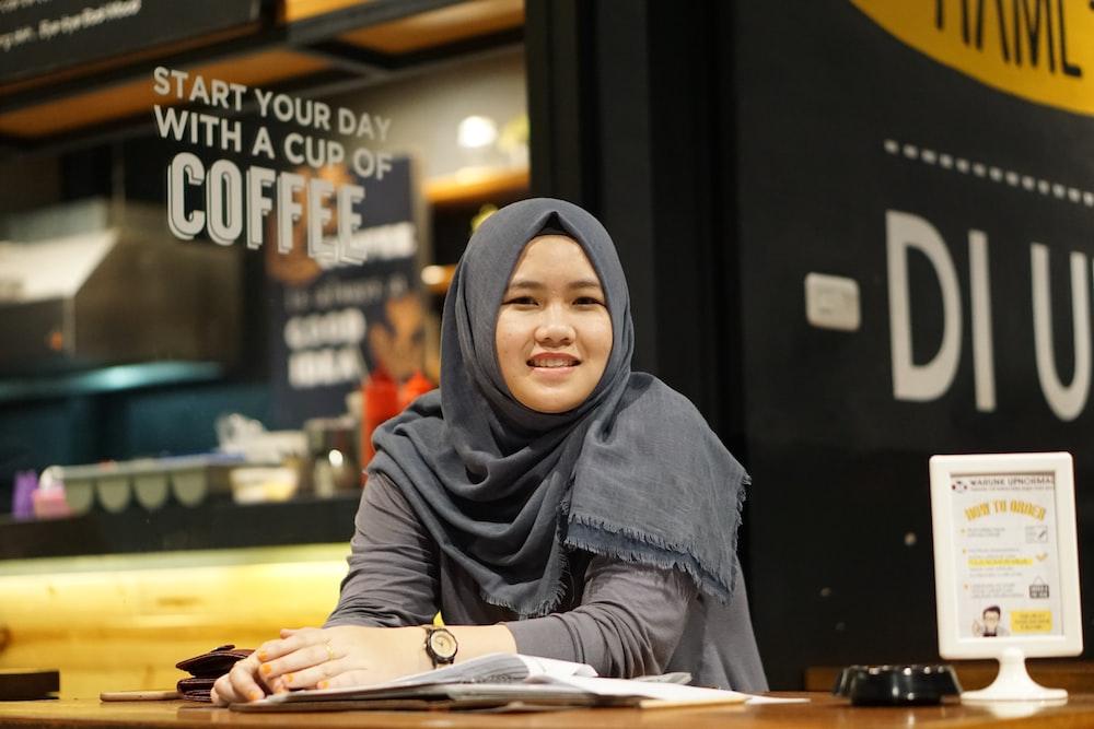 woman wearing gray hijab headdress