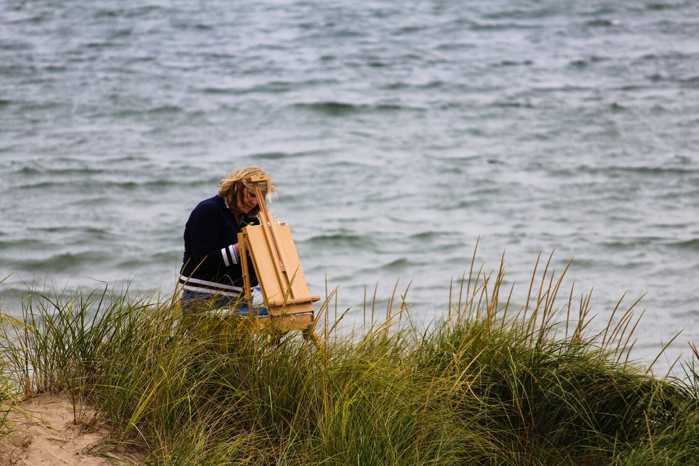 person standing at the back of an easel