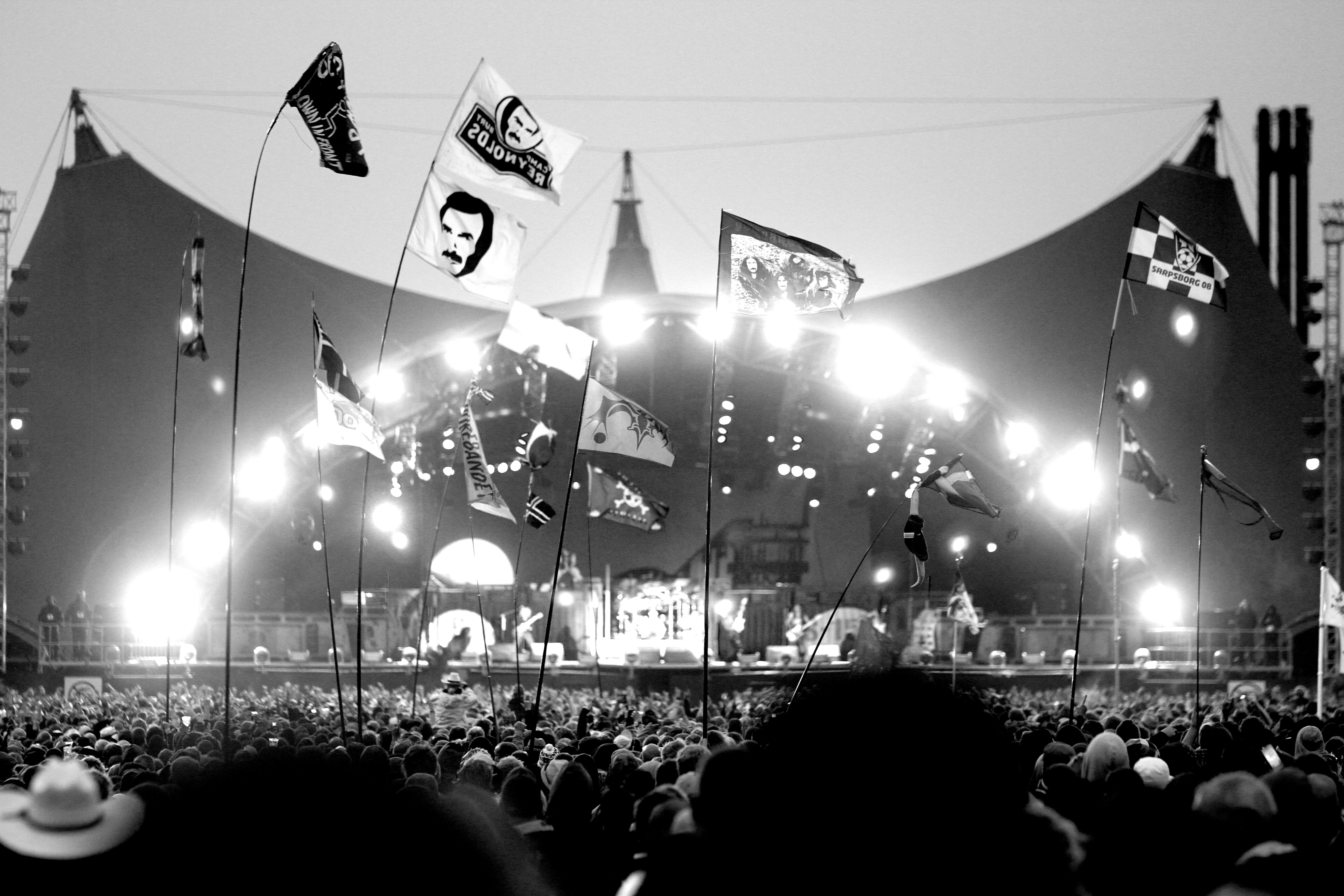 grayscale photo of people near stage