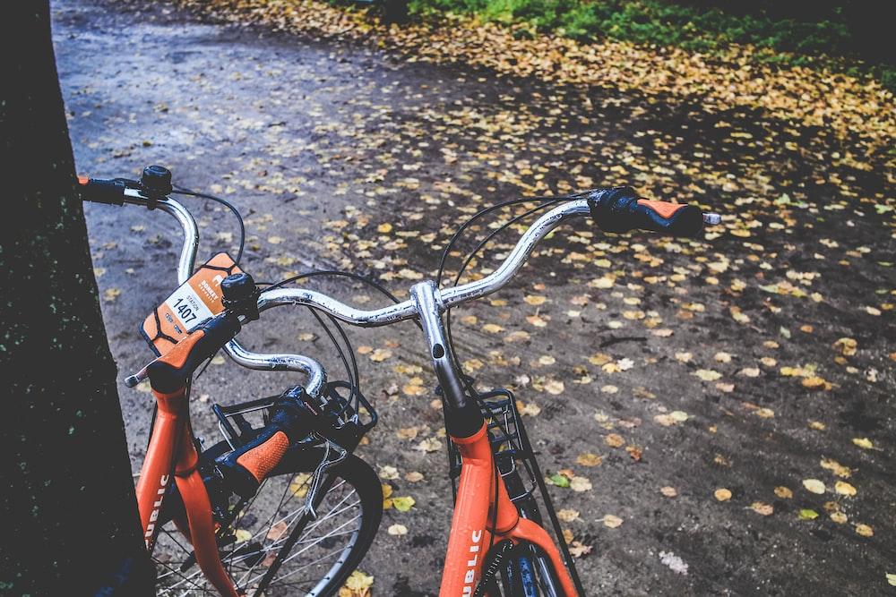 two orange bicycles