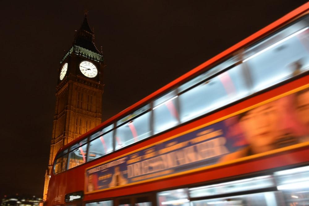double decker bus passing Big Ben tower, London