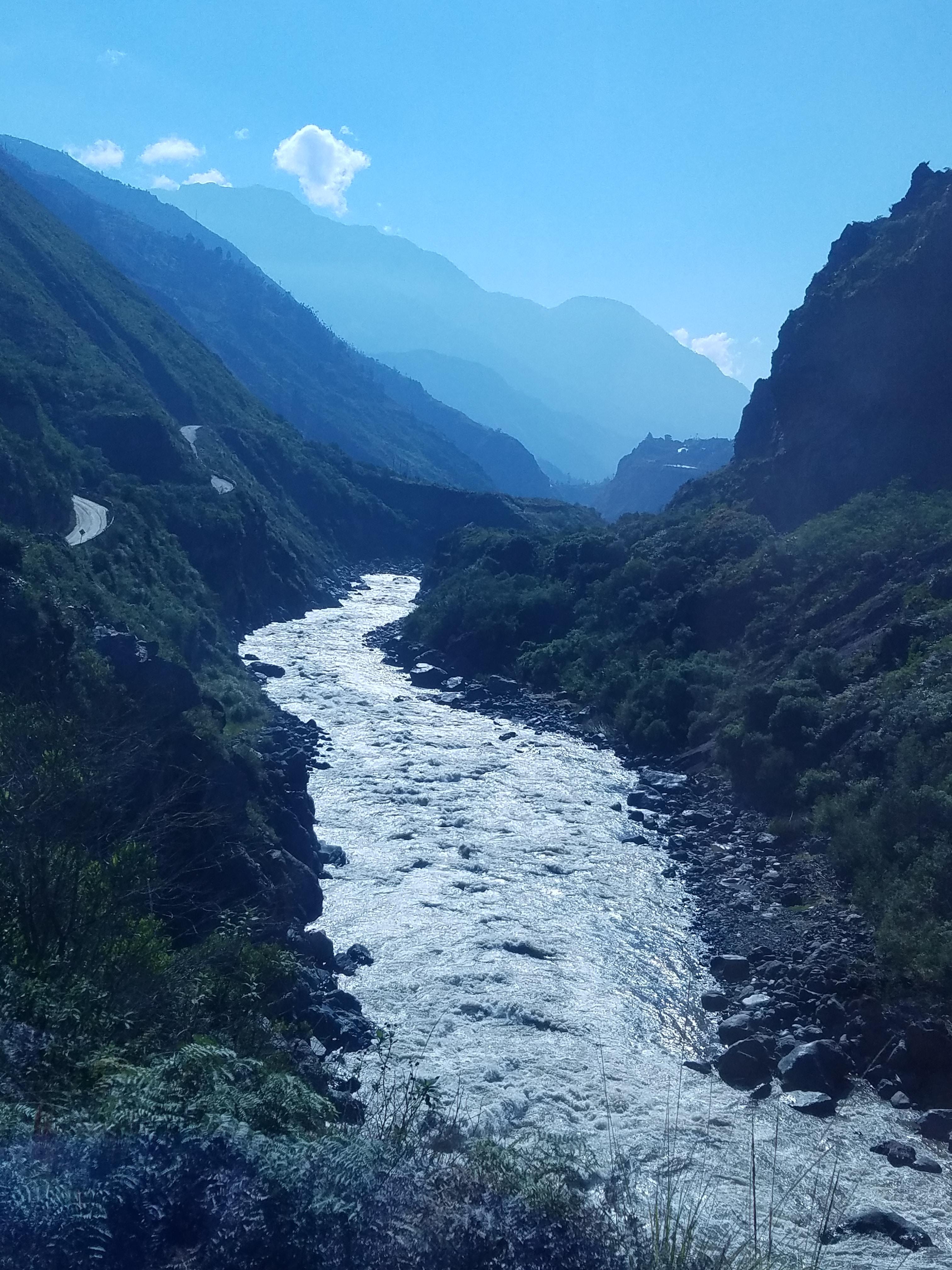 river flowing between green field