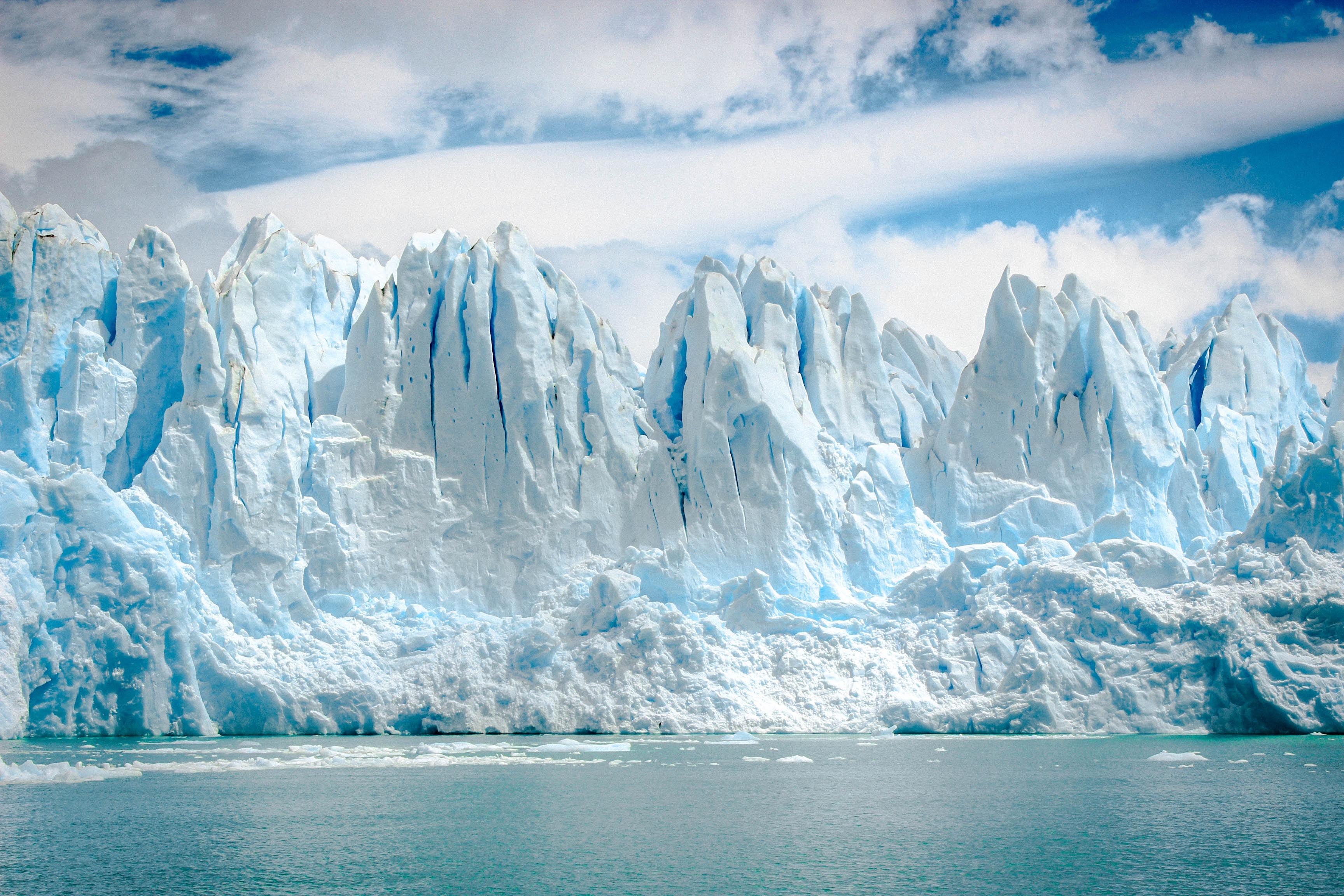 iceberg near body of water