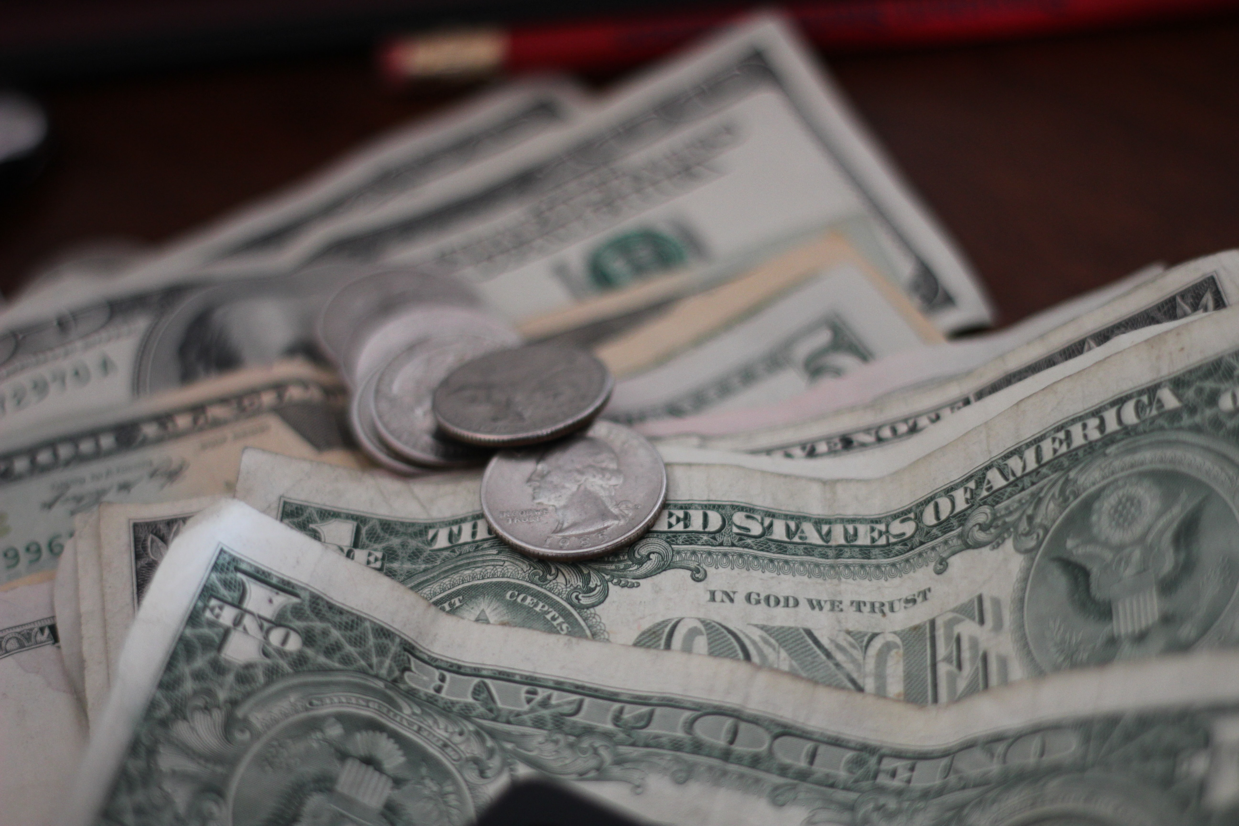 photo of dollar coins and banknotes