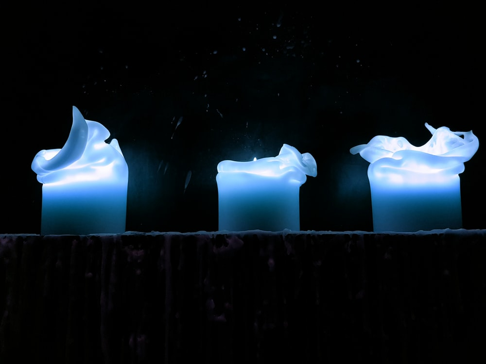 three blue glass ornaments