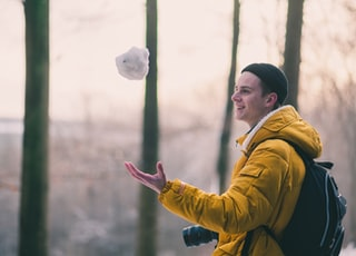 selective focus photo of man catching snowball