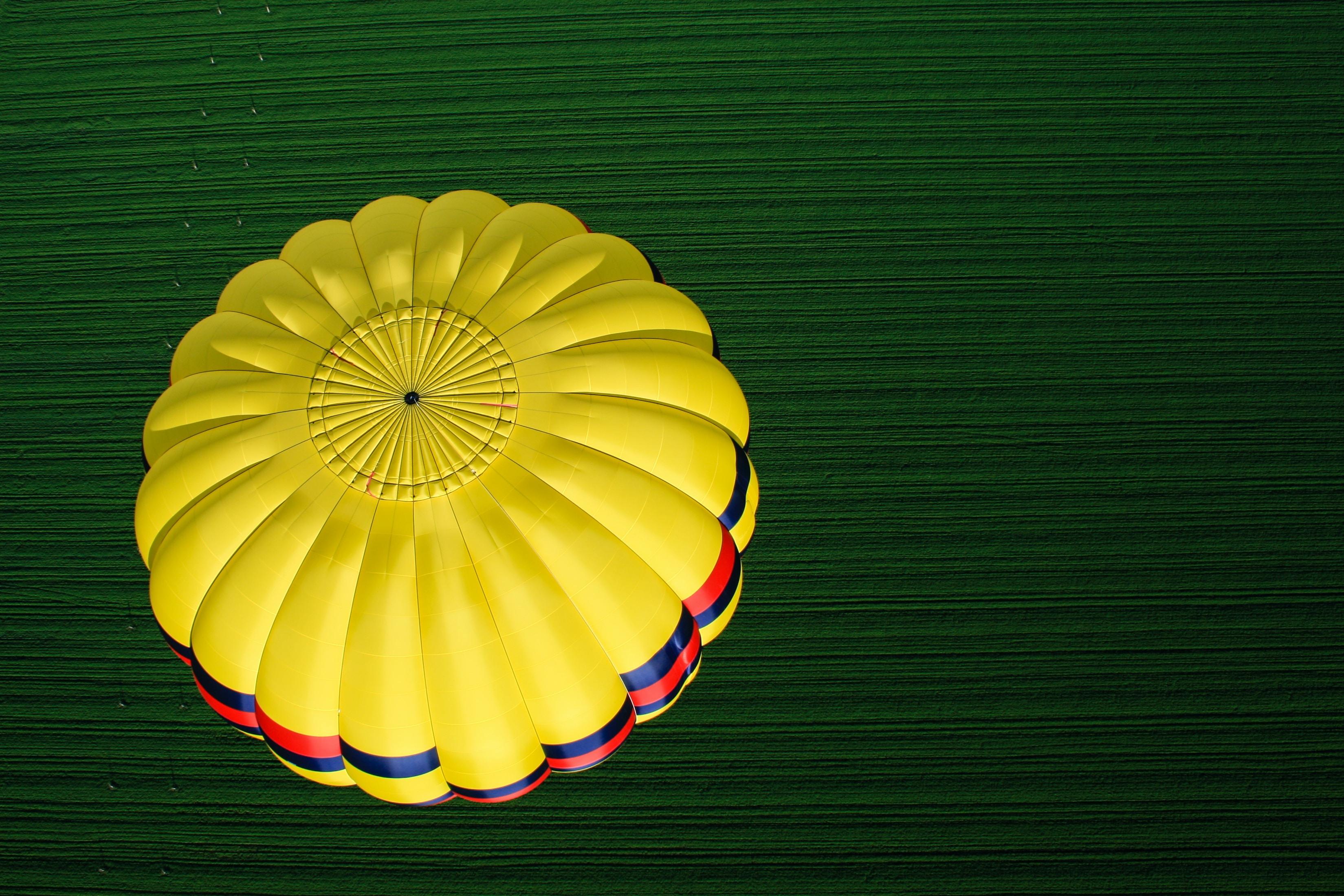 photo of yellow parachute