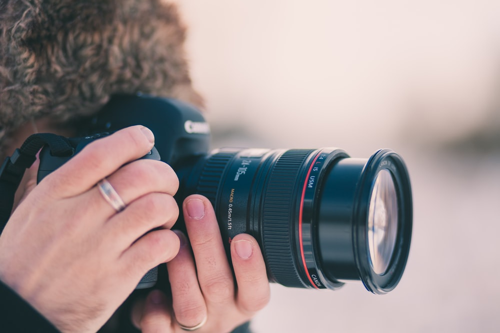 black Canon DSLR camera