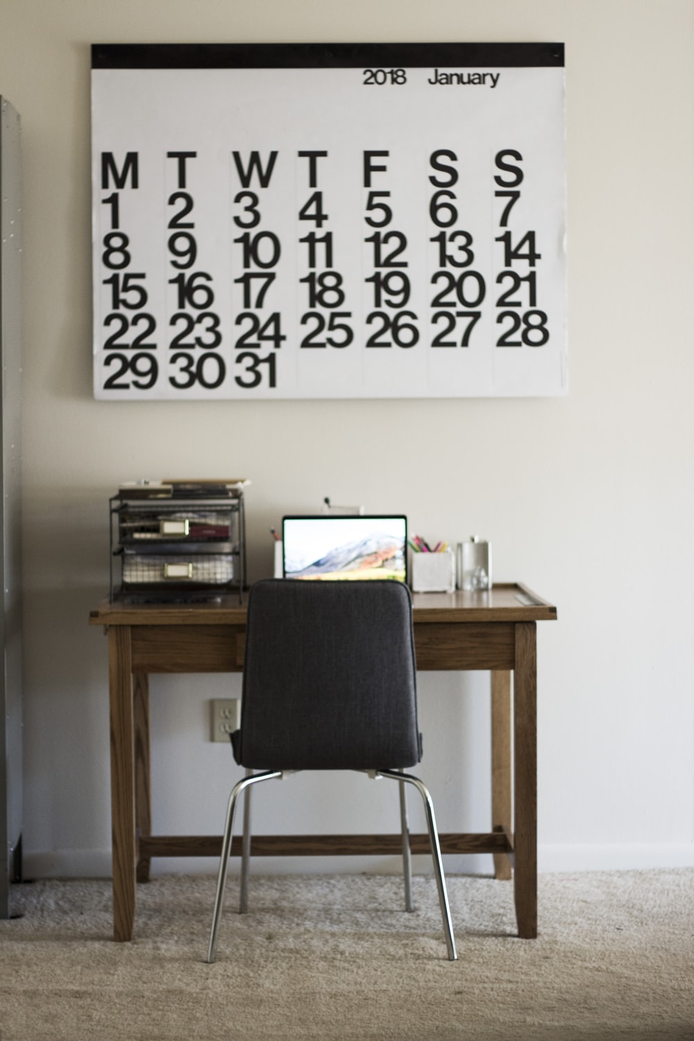 black chair in front of turned on laptop