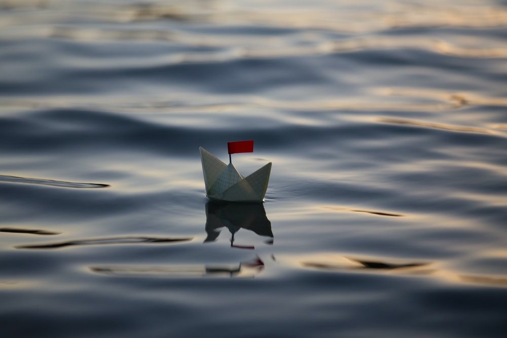 closeup photo of white paper boat