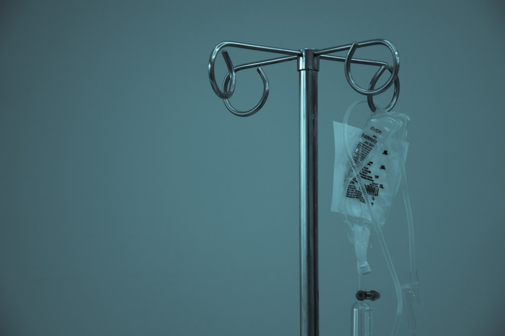dextrose hanging on stainless steel IV stand