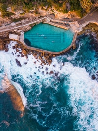 photo of pool near body of water