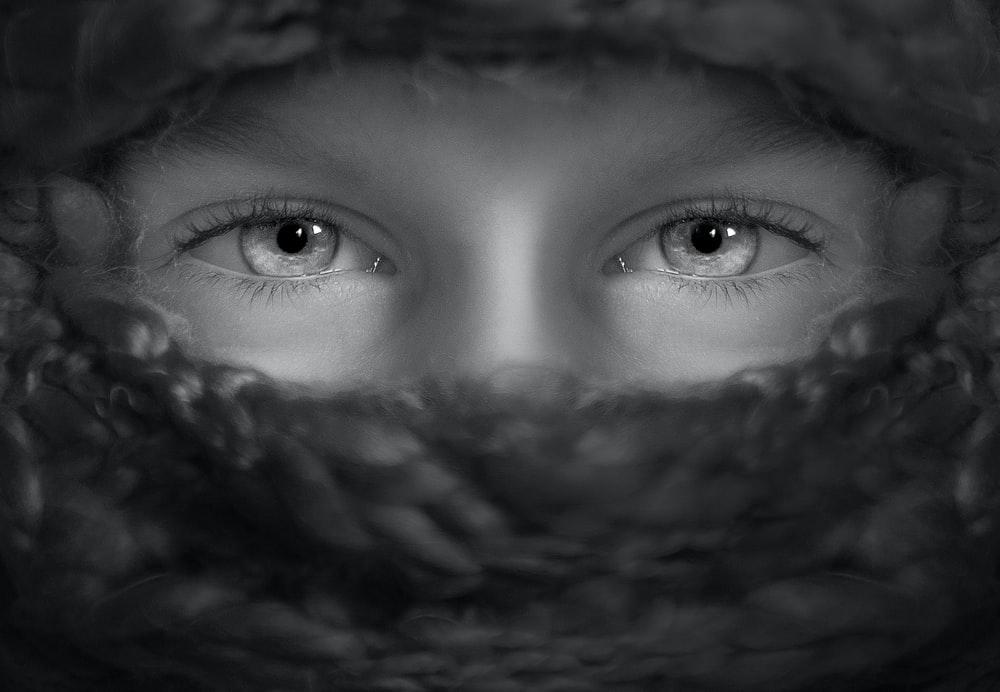 grayscale shot of person's eyes