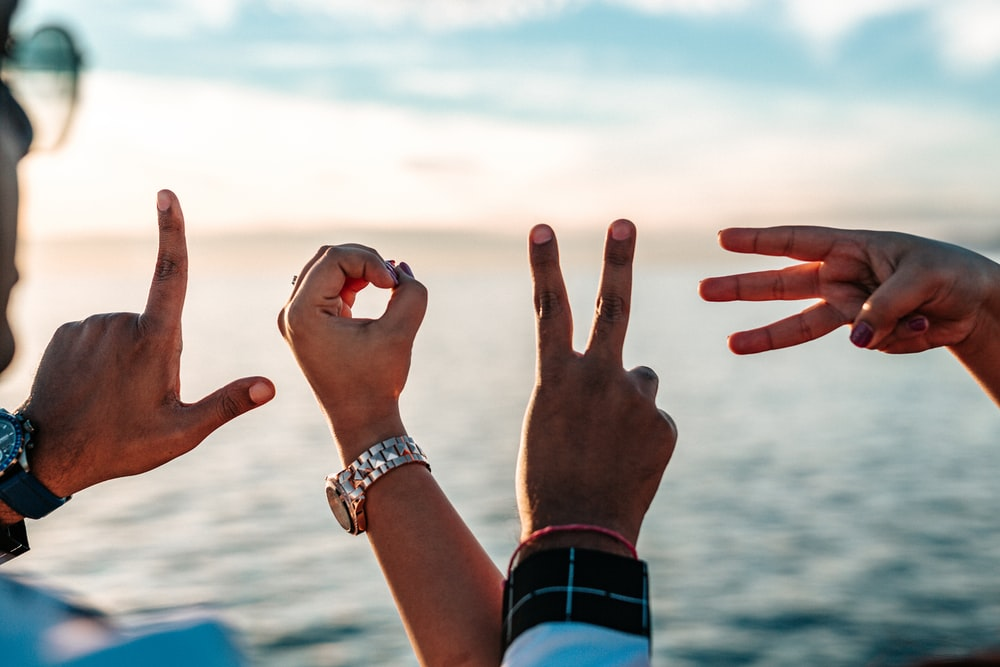 500 hand gestures pictures hd download free images on unsplash