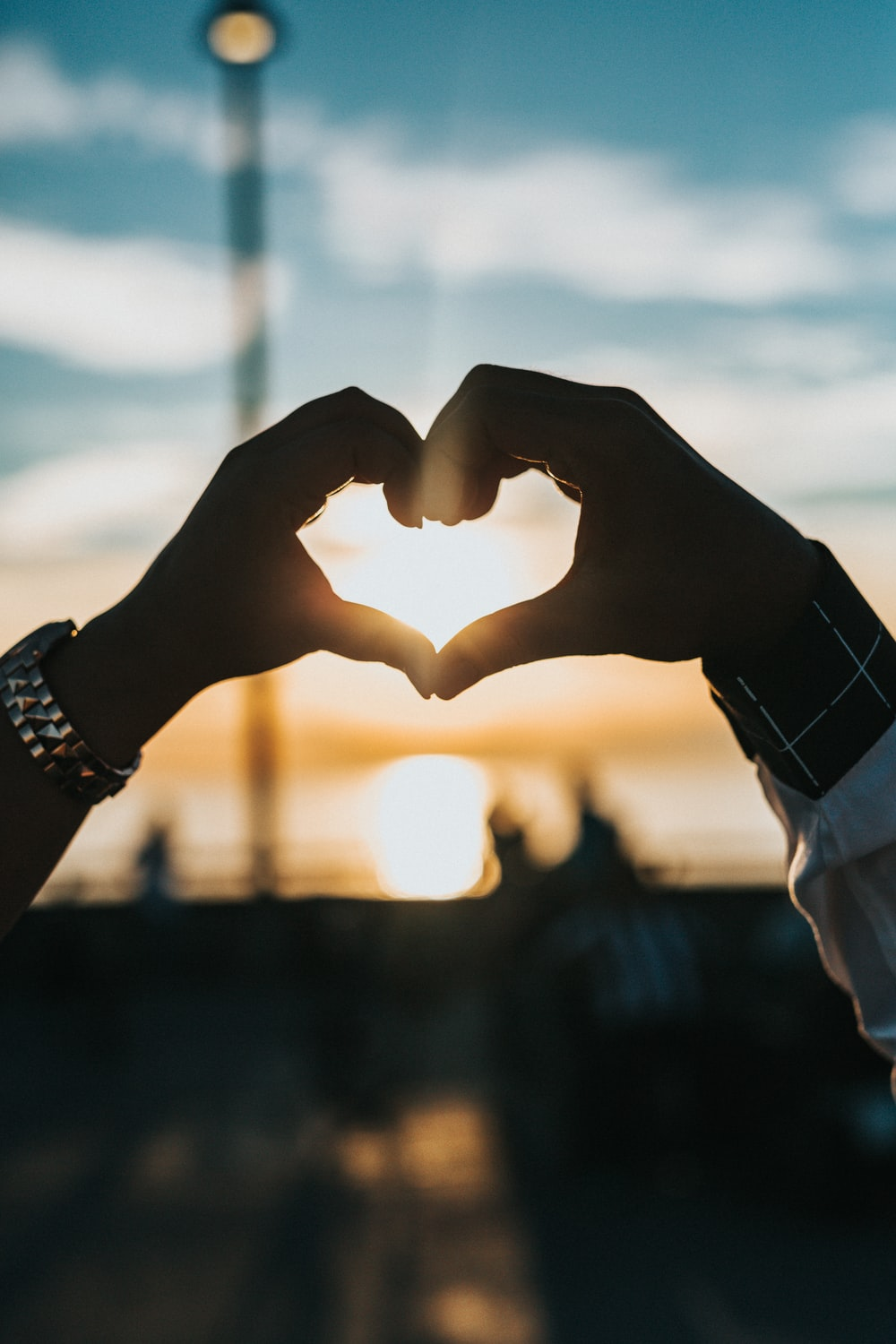 Person Forming Heart With Their Hands Photo Free Love Image On