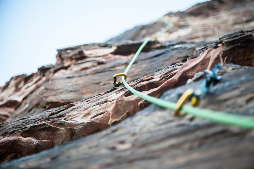selective focus photo of green climbing safety rope