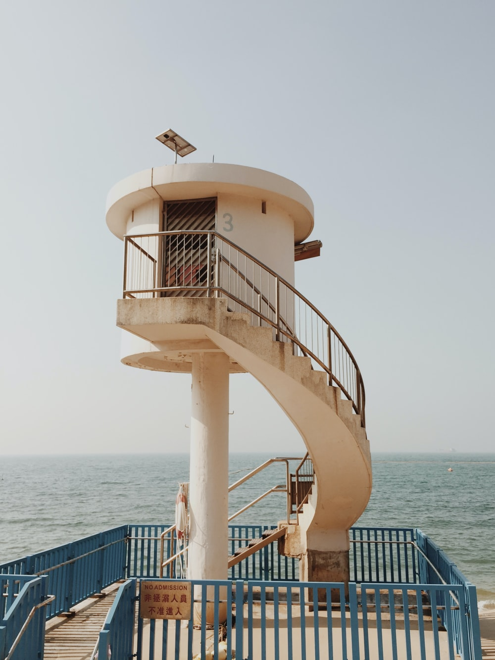 round tower near body of water