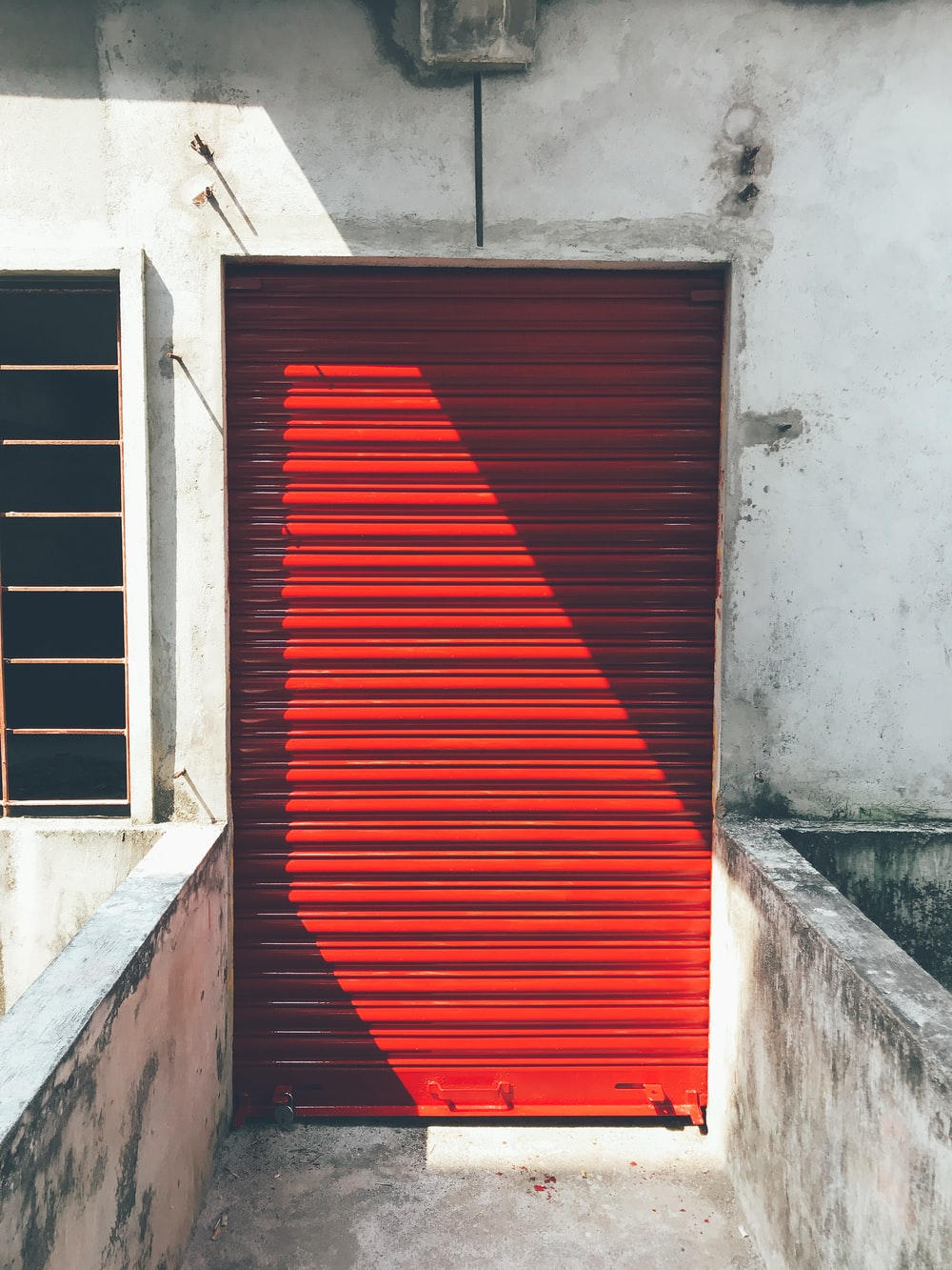 closed red roller shutter