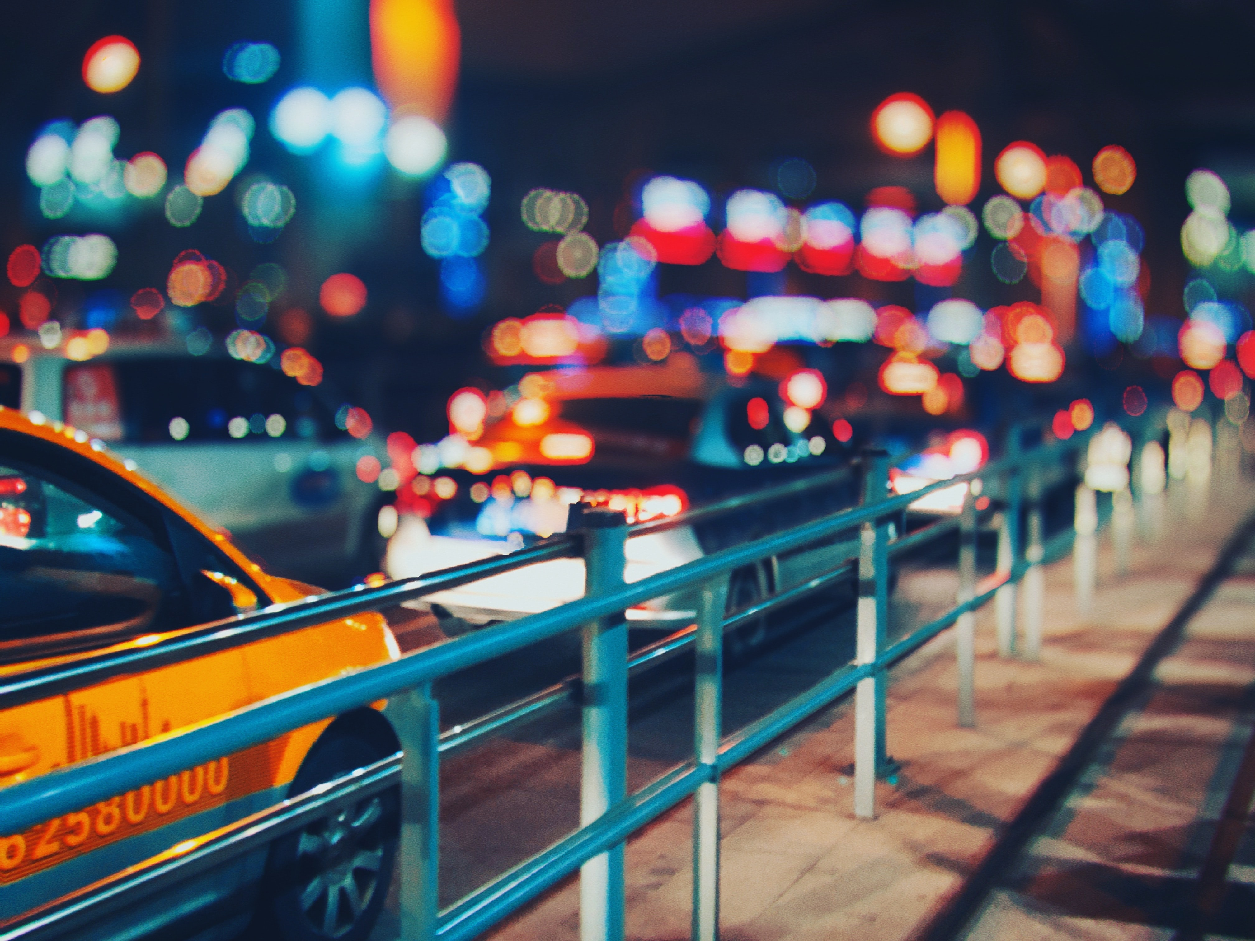 selective focus photo of cars on road with bokeh lights