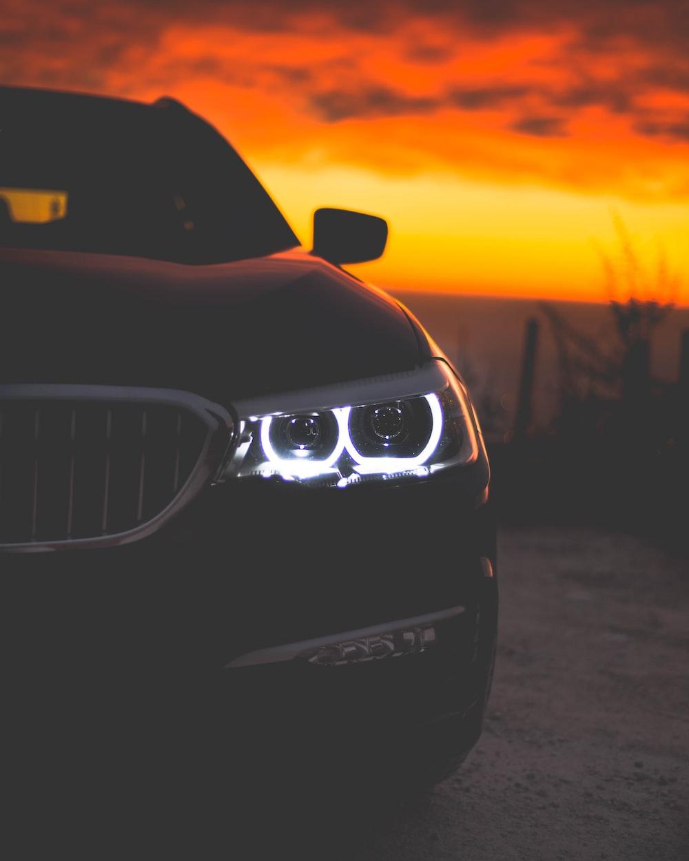 black car during sunset