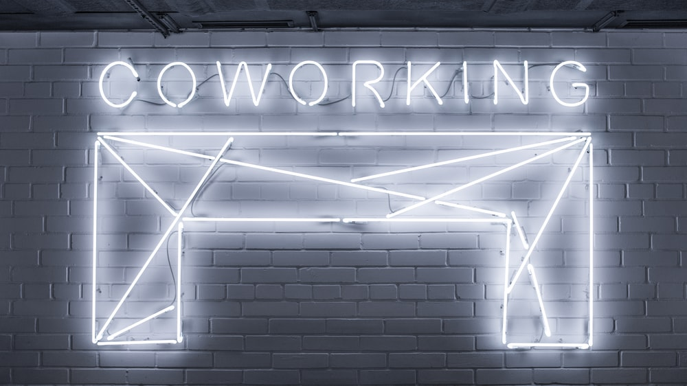 closeup photo of Co Working neon light sign
