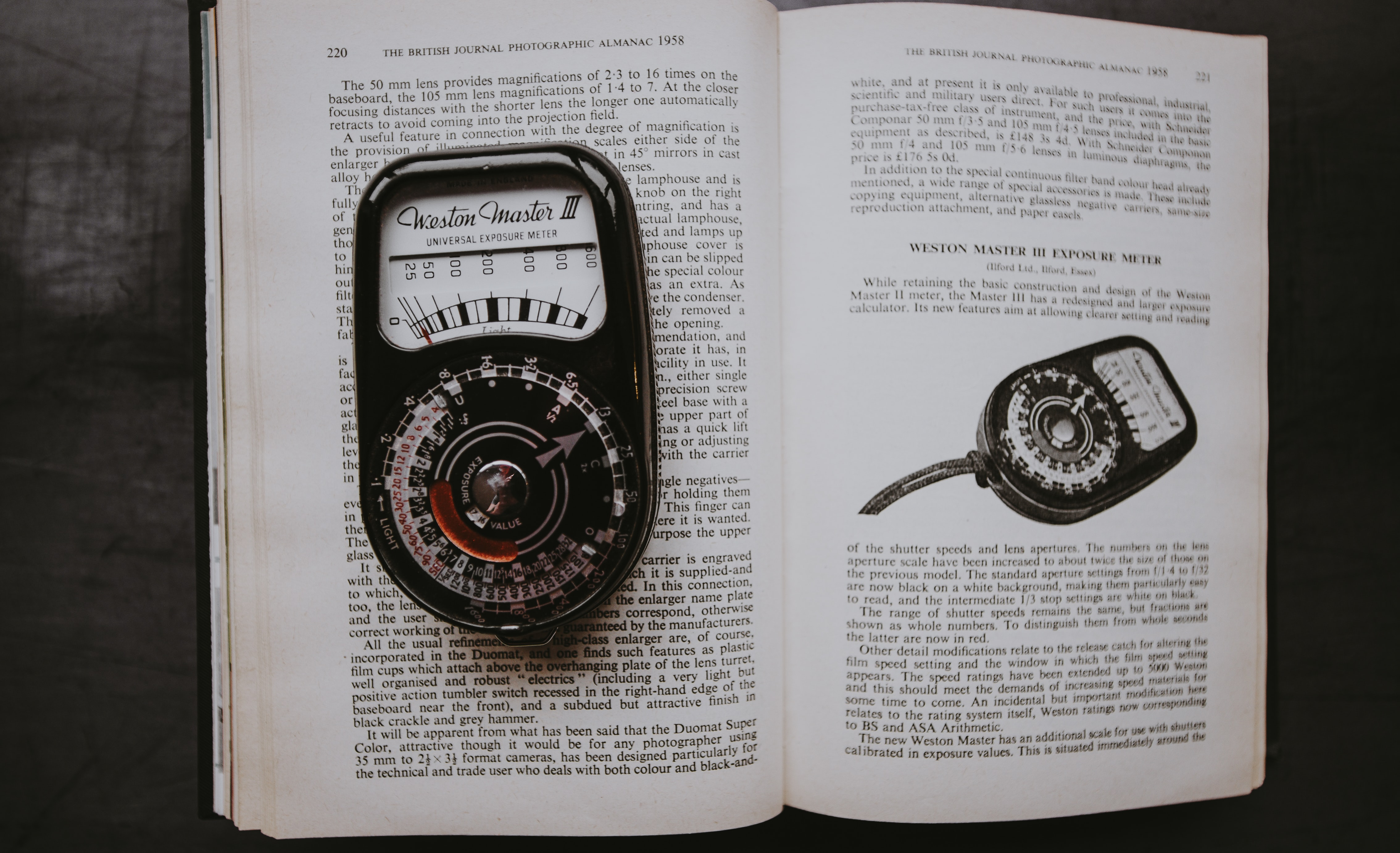 black measuring tool on opened book