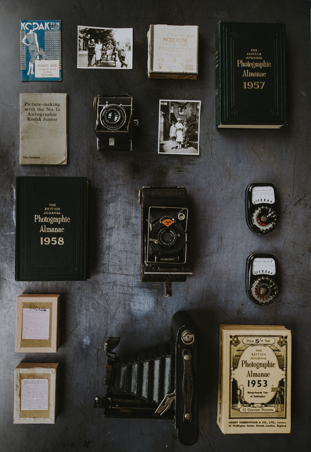 flat lay photography of classic cameras and films