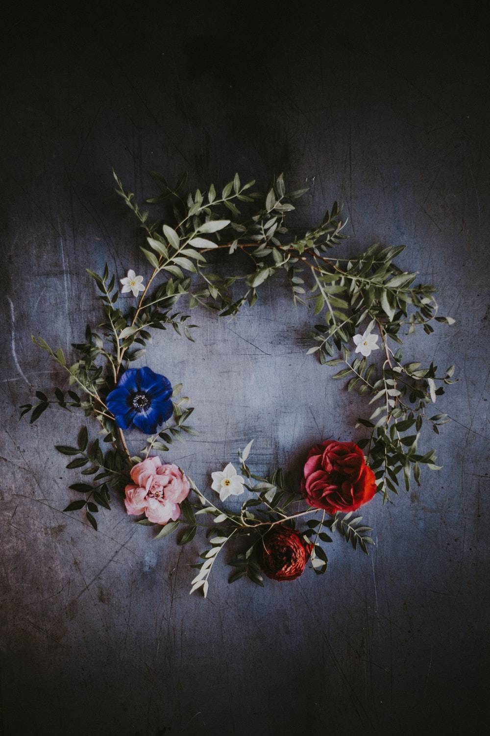 blue, red, and pink floral wreath