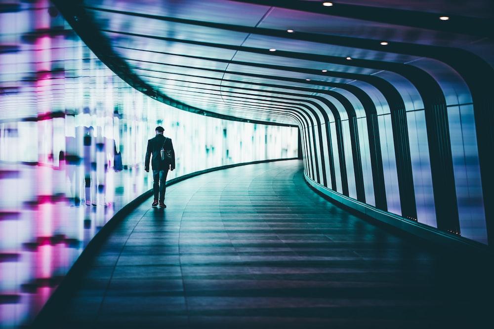 person walking along corridors ]